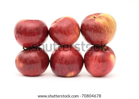 Apples, arrayed on a white background