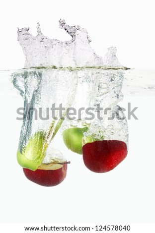 Apples falls deeply under water with a big splash.