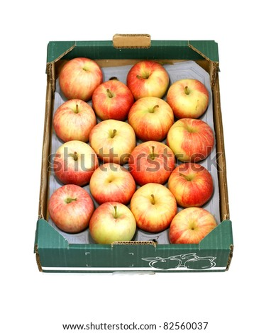 Apples in a cardboard box isolated on white background
