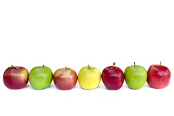 Apples in a row, isolated on white.  Includes fuji, granny smith, golden delicious, and red delicious.