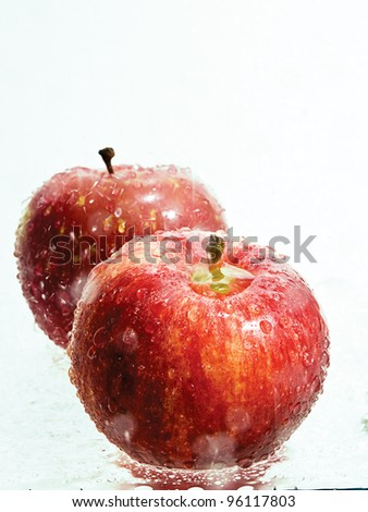 Apples in a splash of fresh water