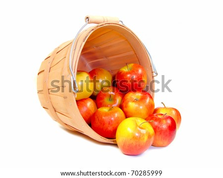 Apples in a wooden farmer's basket, isolated