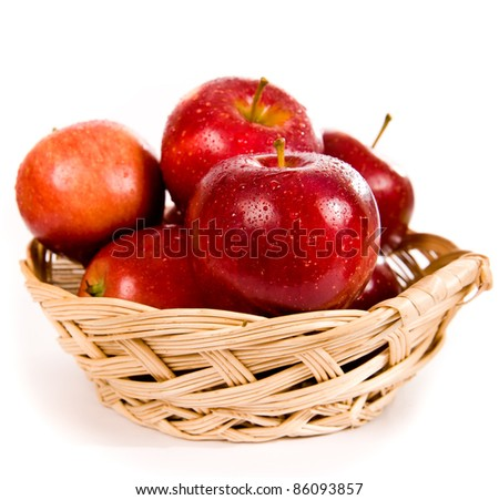 Apples in a yellow basket on white