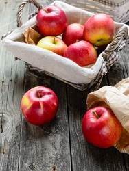 Apples in basket on old grey wood table