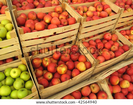 apples in crates on market