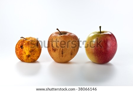 Apples in different stages of ageing, isolated on white - stock photo