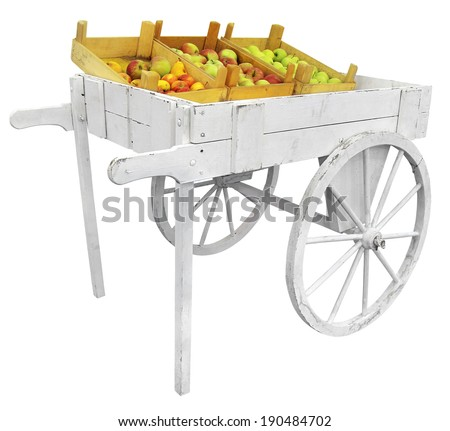 apples on a white wooden cart ...