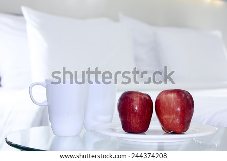 Apples  present for breakfast in the bedroom.
