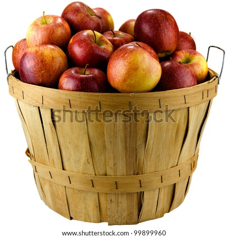Apples sitting in a wooden basket isolated on white background.
