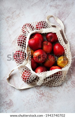 Apples starking in the mesh bag. Sustainability and conscious consuming concept. Top View. Flat Lay Stock photo ©