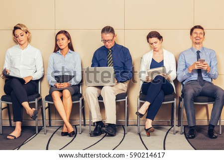 Applicants in Formal Clothes Sitting and Waiting - Shutterstock ID 590214617