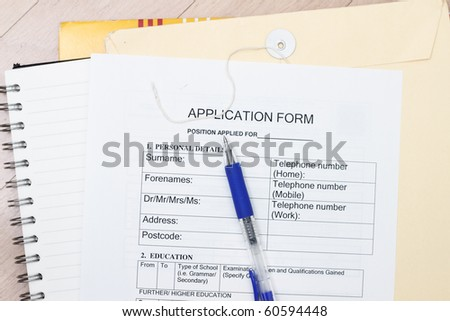 Application form ready to fill up with pen and envelopes