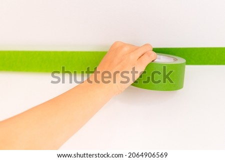 Application of multi surface painters masking tape before painting the walls, Process of preparation, Decorating For Sharp Lines and No Paint Bleed