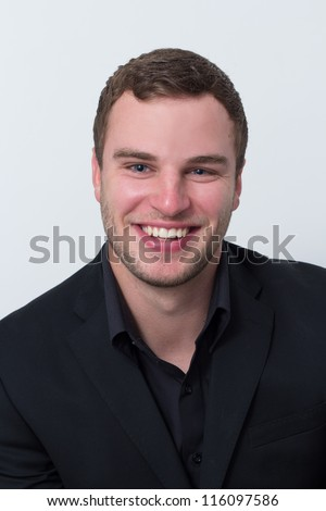 application photo of a young man who is smiling - stock photo