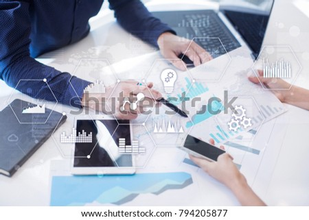 Applications icons and graphs on virtual screen. Business, internet and technology concept.
