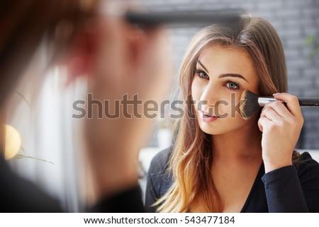 Applying makeup carefully