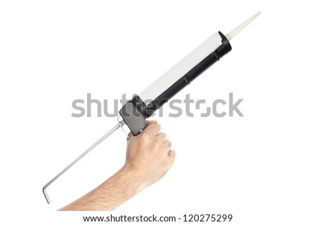 Applying silicone with caulking gun isolated on white, clipping path included