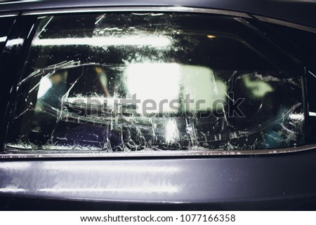 Applying tinting foil on car window in garage #1077166358