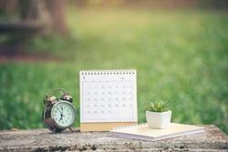 Appointment and Calendar background Concept. Desktop Calendar 2021place on office desk. Calender and notebook for Planner to plan timetable, agenda, organization, management each date, month and year