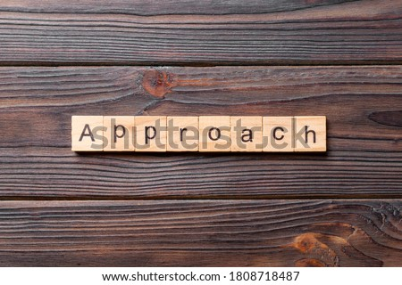APPROACH word written on wood block. APPROACH text on cement table for your desing, concept. Stock photo ©