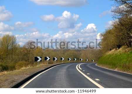 Approaching a sharp bend on a rural road with views of the countryside.