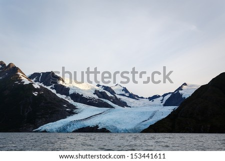 Approaching Portage glacier from lake in Alaskan wilderness in summer