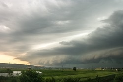 Approaching shelf cloud of a severe thunderstorm over the city of Targu Mures, Romania in eastern Europe