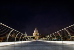 Approaching St Paul's Cathedral in London on the Millennium Bridge in the Night at Christmas Time