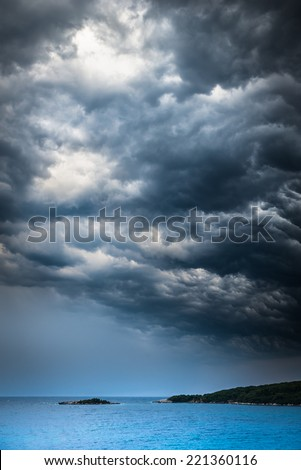 approaching storm weather over a turquoise Mediterranean sea and small islands
