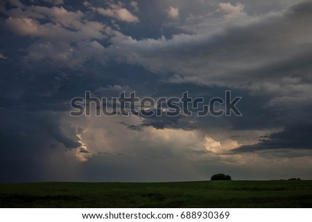 Approaching Storm with Beautiful Clouds in the Country #688930369