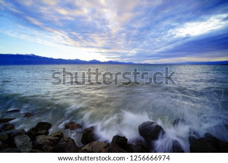 Approaching sundown by the shores of Lake Geneva (Lake Leman) on a winter's day #1256666974