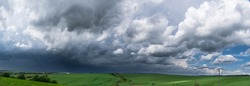 Approaching supercell thunderstorm in the village, squall line, storm clouds