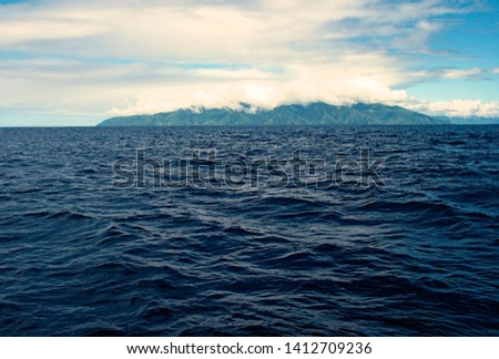 Approaching Tahiti / Tahiti Iti, view from the deck of a cruising ship.  #1412709236