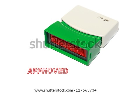 approved stamp press on white paper