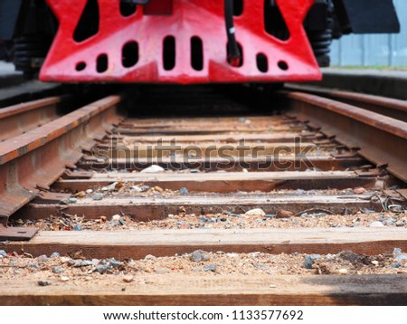 Approximation of the old train, low, view from below. Rails close-up. Beware of the train!