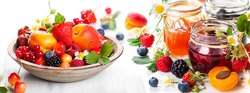 Apricot, blackberry, strawberry jam, fresh berries and fruits on white background