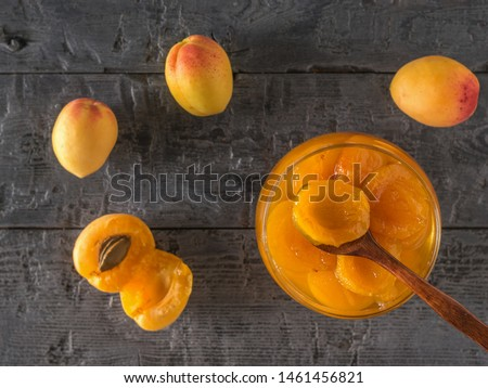 Apricot fruit with freshly made homemade jam on a wooden table. Freshly made homemade jam.