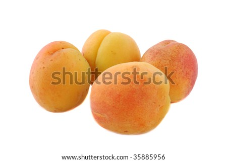 Apricot fruits combined by mountain on a white background.