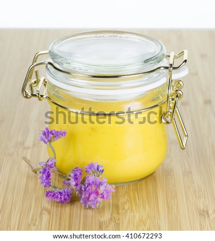 Apricot  jam on a rustic plate background. Provence mood. #410672293