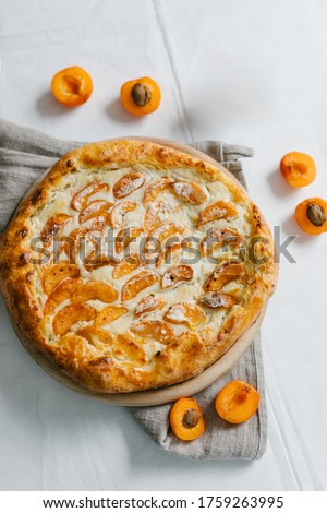 Apricot pie. Apricot pizza, delicious and sweet. Homemade fruit pie (galette) made with fresh organic apricotes. Open pie, apricot tart. Fruit bakery. Summer pie.