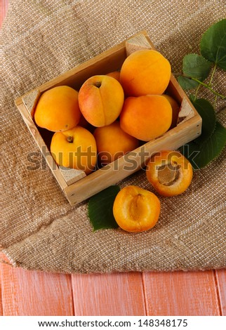Apricots in drawer on bagging on wooden table #148348175