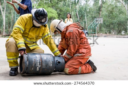 April 29, 2015 Bangkok, Thailand: Fireman wearing his uniform with gas tank on fire training for beginner