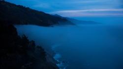 APRIL 7, 2019, CENTRAL COAST, CA., USA - California Coast Pacific Coast HIghway at dusk with fog