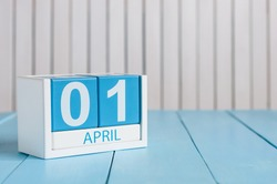 April 1st. Image of april 1 wooden color calendar on white background.  Spring day, empty space for text. All Fool's Day