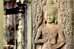 Apsara carved at a stone wall at the Angkor Wat temple in Siem Reap Cambodia. Constructed as a Hindu god Vishnu temple for the Khmer Empire it transformed into a Buddhist temple in 12th Century.