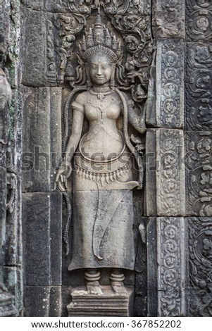Apsara old stone statue , Angkor Wat, Cambodia