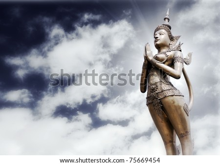 apsonsi-thai magnificent statue against cloudy sky background