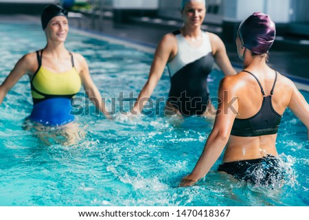 Aqua Aerobic Training in Water Sport Centre. Group of Women Exercising in the Pool.