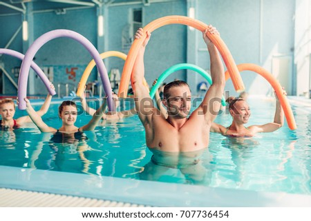Aqua aerobics exercises, women with male trainer