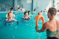 Aqua aerobics, women class with male trainer